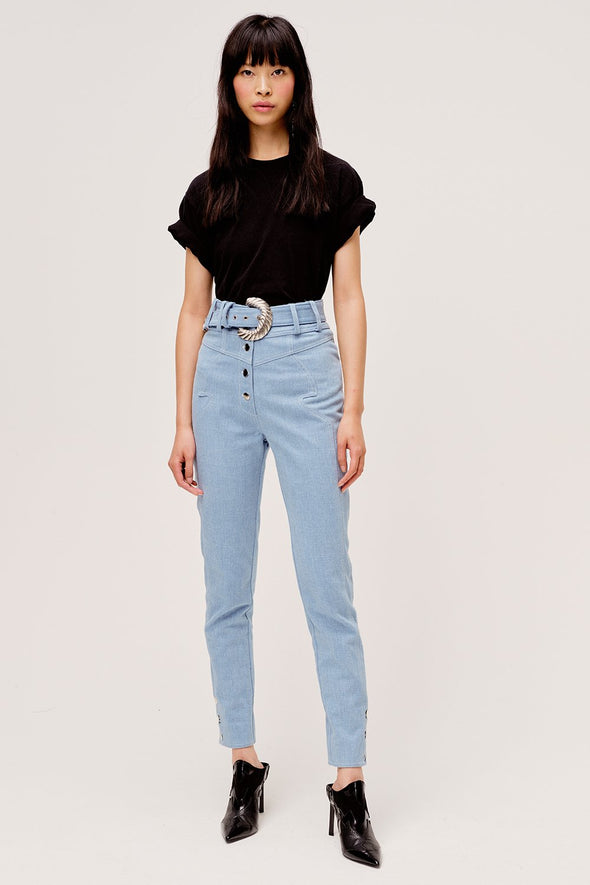 The Josephine High Waist Pant from For Love & Lemons is a western inspired blue jean with removable tonal belt and contrast metal buttons.