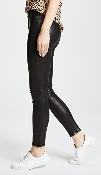 Slim fit, black leather pants from FRAME with gold hardware.