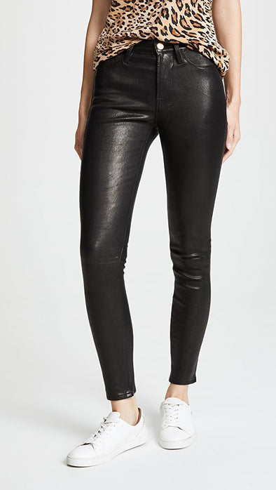 The Le High Skinny Leather is a lambskin leather pant from FRAME with an ankle length, slim fit leg and gold hardware details.