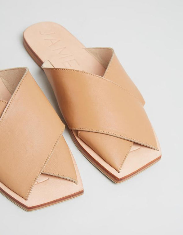 The Poseidon Slide in Tan by James Smith is a versatile slide. The sandal features beautiful leather cross straps in a tan leather with a pressed leather sole.