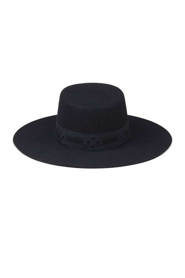 100% Australian wool wide brimmed boater hat from Lack of Color. The black wool hat is embellished with a 1050s vintage ribbon.