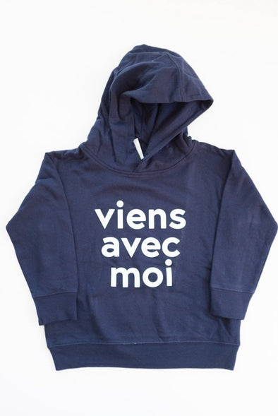 VAM Toddler & Youth Hoodie in Navy. Cotton fleece hood with a white Viens Avec Moi logo screen print on the front.