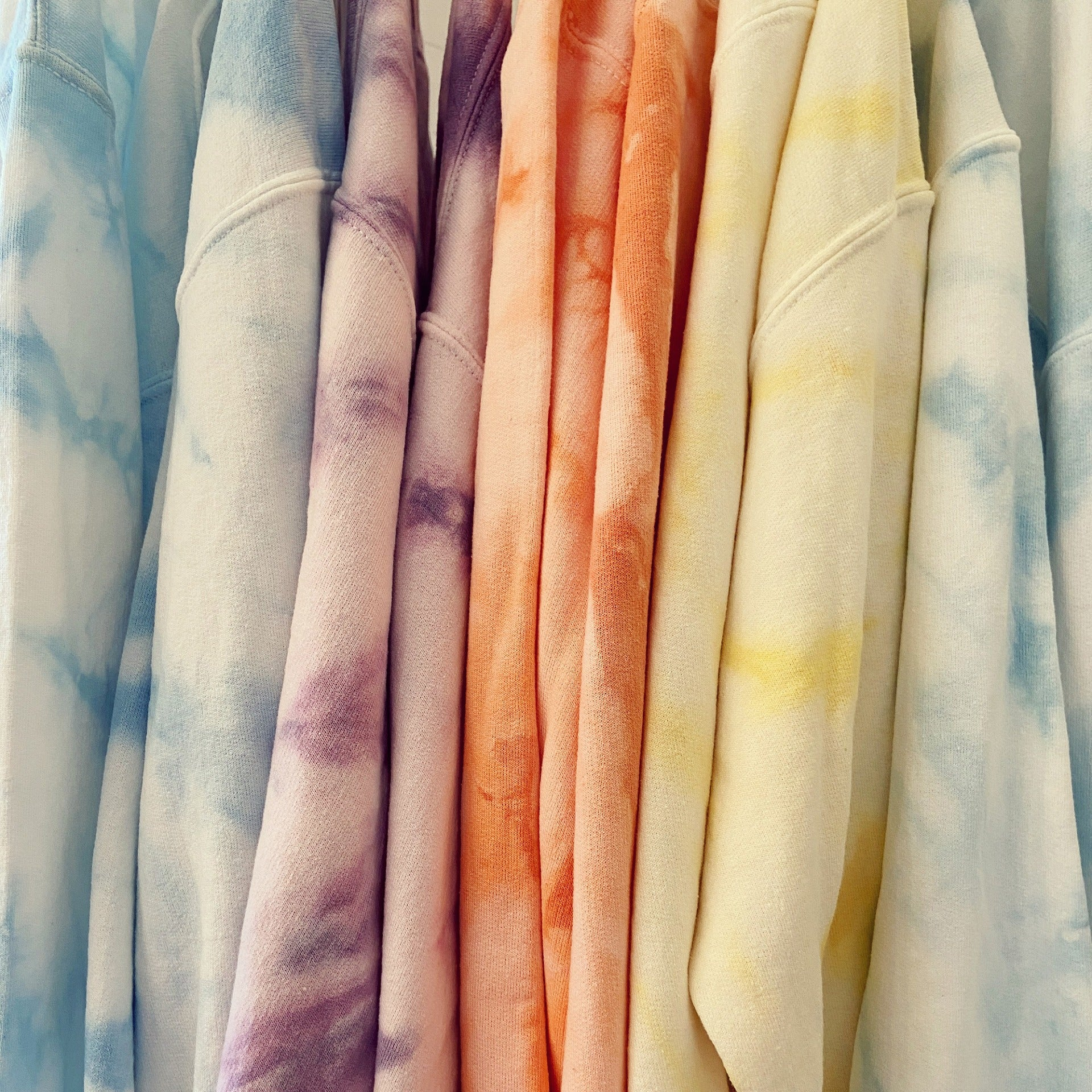 One of a kind tie dye crew neck sweaters from Viens Avec Moi.