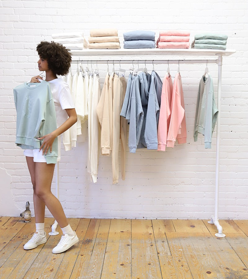 Nude, pink, blue and pastel green crewneck sweaters made from eco-friendly fabrics.