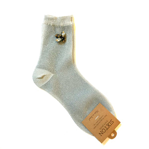 Rio socks with a bee pin