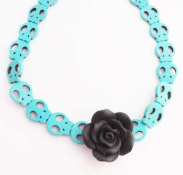 Aqua Skulls Necklace With Black Rose