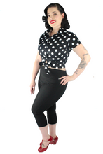 Load image into Gallery viewer, Model wearing knot top with black capri pants, side