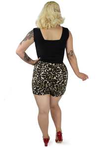 Model wearing leopard high waisted shorts back side