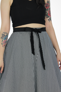 Close up of model wearing skirt with black blouse