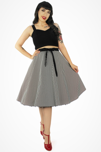 Model wearing skirt with black blouse
