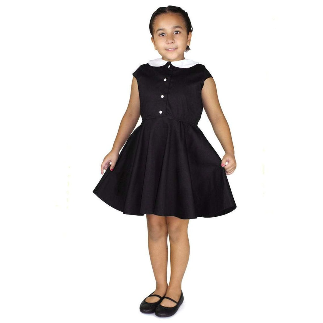 model wearing Girl's Wednesday Addams Inspired Dress With Snaps