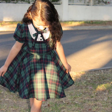 Model wearing Girl's Holiday Green Plaid Dress