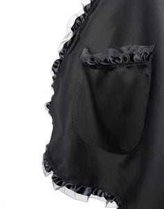 Close up of apron, black apron, large side pocket, trim detail