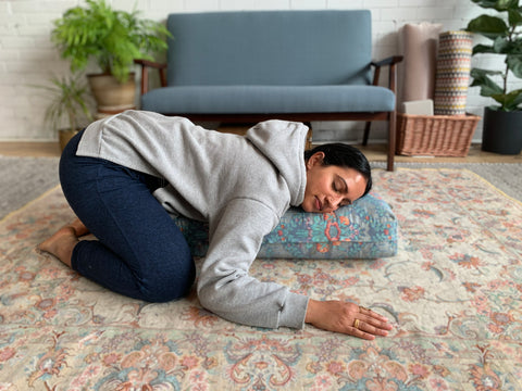 child's pose with bolster to unwind