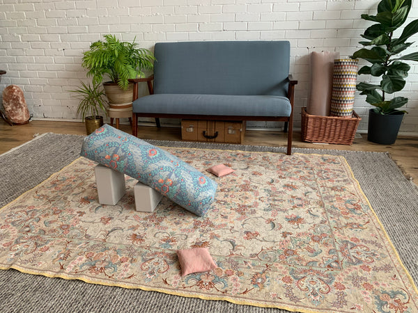 Restorative Yoga Home Set up with Bolsters and Blocks