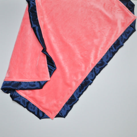Coral Minky Baby Blanket With Navy Satin Trim