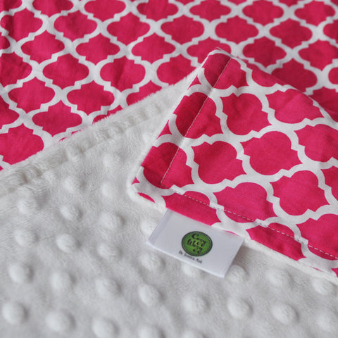 Pink lattice print baby blanket with white minky