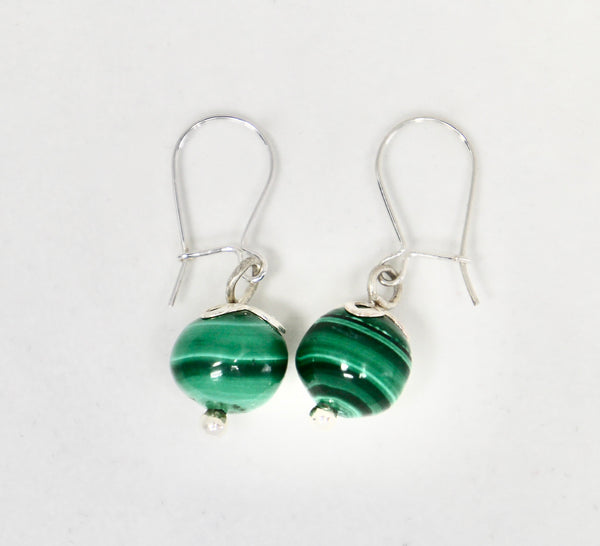 Malachite Fruit earrings are handmade by Lorena Sanabria Jewelry with sterling silver and malachite stones responsibly sourced at a vintage store in Stockholm.