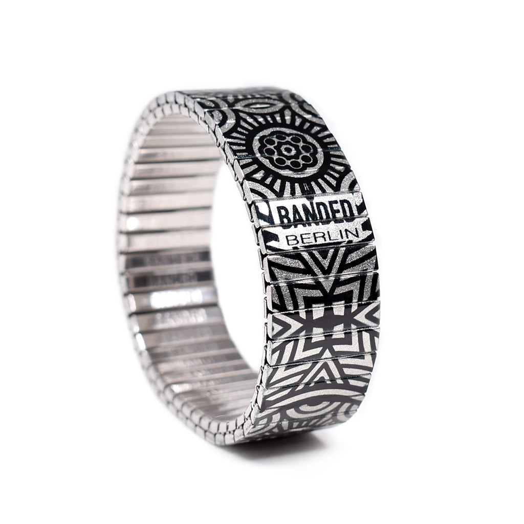 Gaudi's Footsteps - El Capitan Metallic The Pyrenees as seen from above with its borders of black and white that divide the imagination. A style for the explorers of mountainous or emotive ranges. New for Summer 2020 By Banded Berlin Bracelets . Made in Berlin