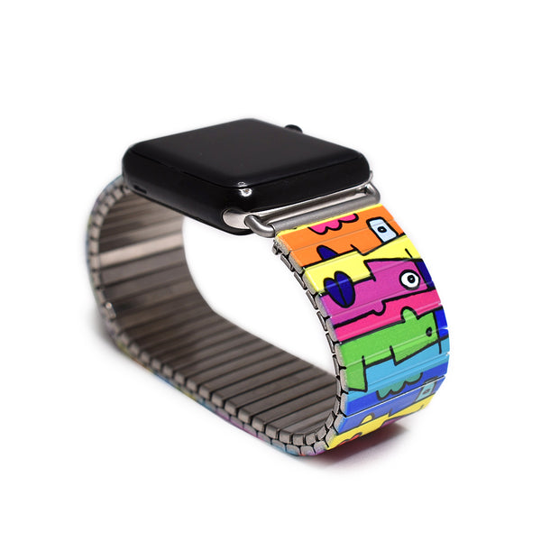 Multi-Kulti Applewatch Banded by Thierry Noir The Colors of this design pop off your wrist like some kine of neon Picasso dream. Part of the Banded Berlin artist series. Limited edition  Stainless steel, nickle free, scratch and watch proof. Apple Watch not included.   Rostfreier Stahl, nickelfrei, kratz- und wasserfest. Compatible with all Apple Watch series 1 through 5.  Applewatch not included.  © 2020, banded berlin.