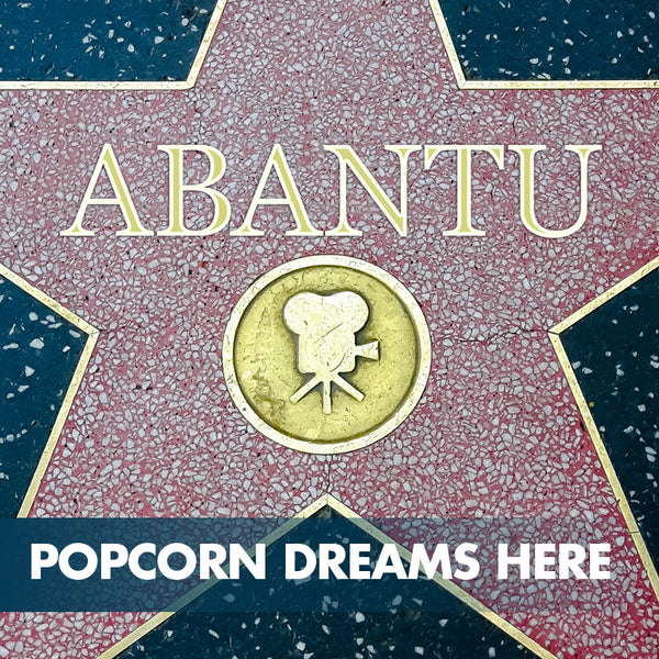 Abantu preps the popcorn bowls to celebrate 25 years of impact on Hollywood