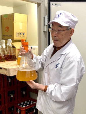 Mr. Takahashi of Saiya Brewery holds  the brewery's 30 year old yeast