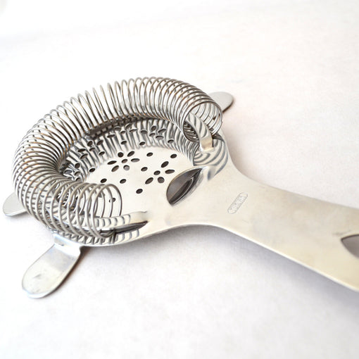hawthorne strainer short Ideal for fast-moving bartenders or for bars with limited space, this Hawthorne strainer is light, easy to use, and ergonomic, thanks to the thumb rest. Shake or stir your cocktail, and the tight coil helps to better strain out ice and any other ingredients as you pour the drink into a glass.