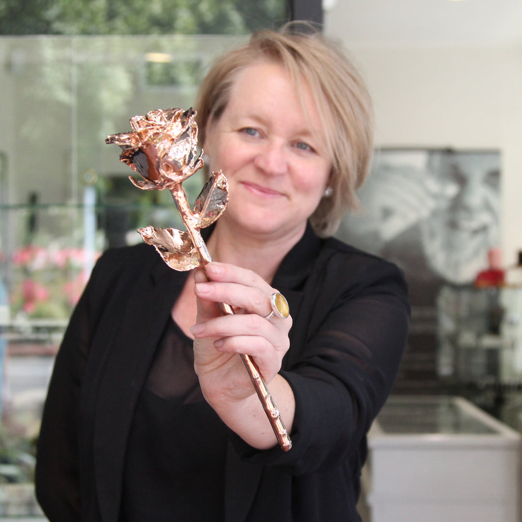 Tanya Rowe with the 24 carat gold-plated rose that the Nelson Weekly and Jens Hansen will be giving away this Valentine's Day. Photo: Jessie Johnston.