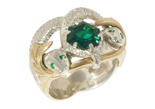 Sterling Silver set with a 8mm Hexagon cut Biron Emerald, and has extended 9ct yellow gold vines with natural round cut Emeralds for the snake's eyes