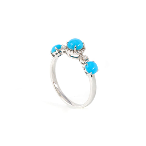 A picture of the 18K white gold turquoise promise/ engagement ring standing up