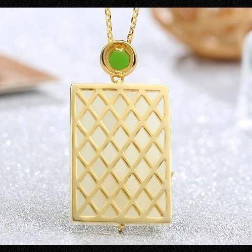 White jade pendant with unique bamboo designs