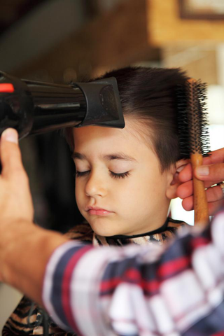 child getting hair blow