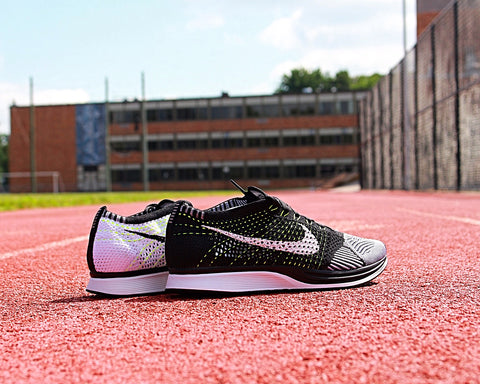 new style 64afa 6a92c The Nike Flyknit Racer Unisex Running Shoe provides an adaptive,  lightweight fit with a racing-specific rubber outsole that delivers  exceptional traction ...