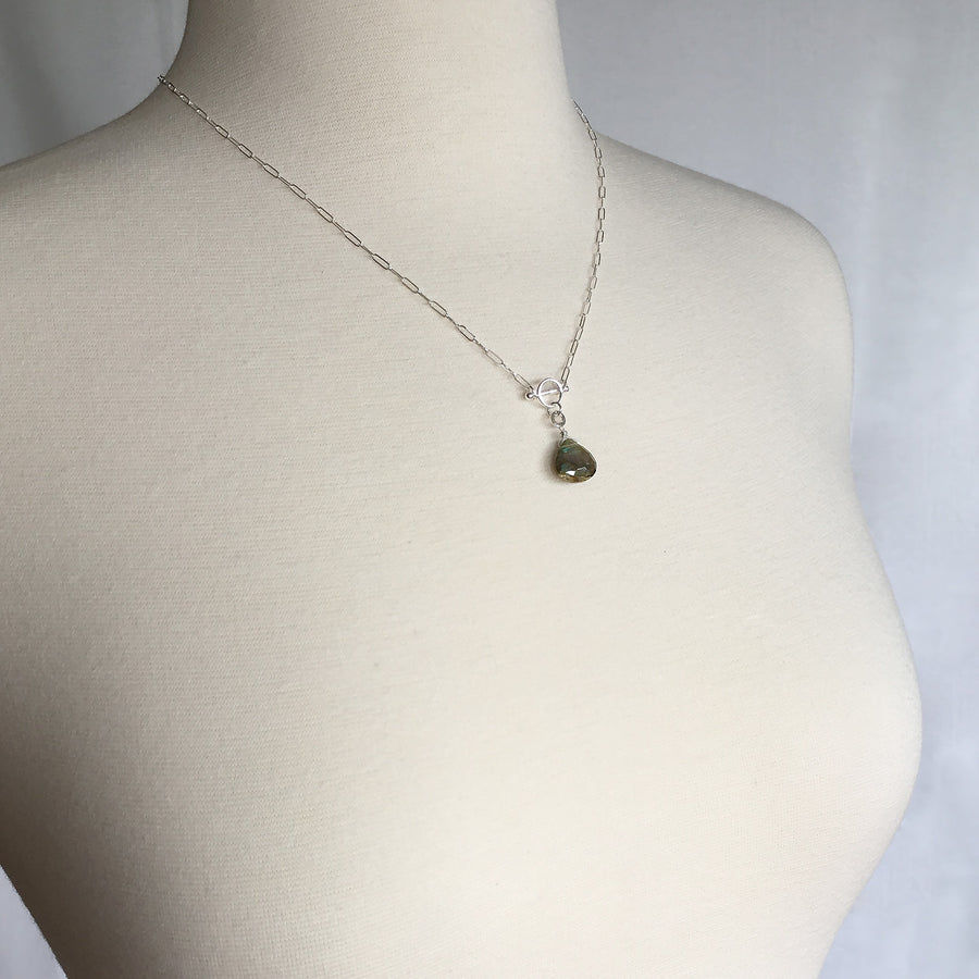 Mannequin Wearing Circle & Bar Handmade Sterling Silver Necklace Iridescent Labradorite Drop