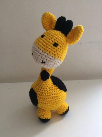Yellow crochet giraffe.