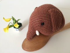Brown crochet elephant.