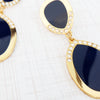 cleo teardrop statement earrings