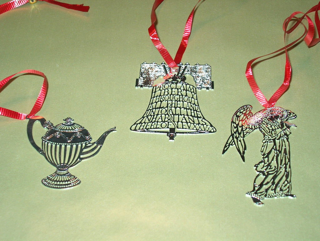 A Selection of finely detailed Silverplate Christmas Ornaments