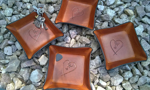 Leather trays with embossed heart.  Perfect wedding or third anniversary gifts!