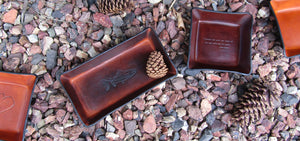 Leather valets, anniversary gifts and religious gifts. Four Robins Ltd.