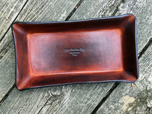 Leather valet tray. Four Robins Ltd logo.