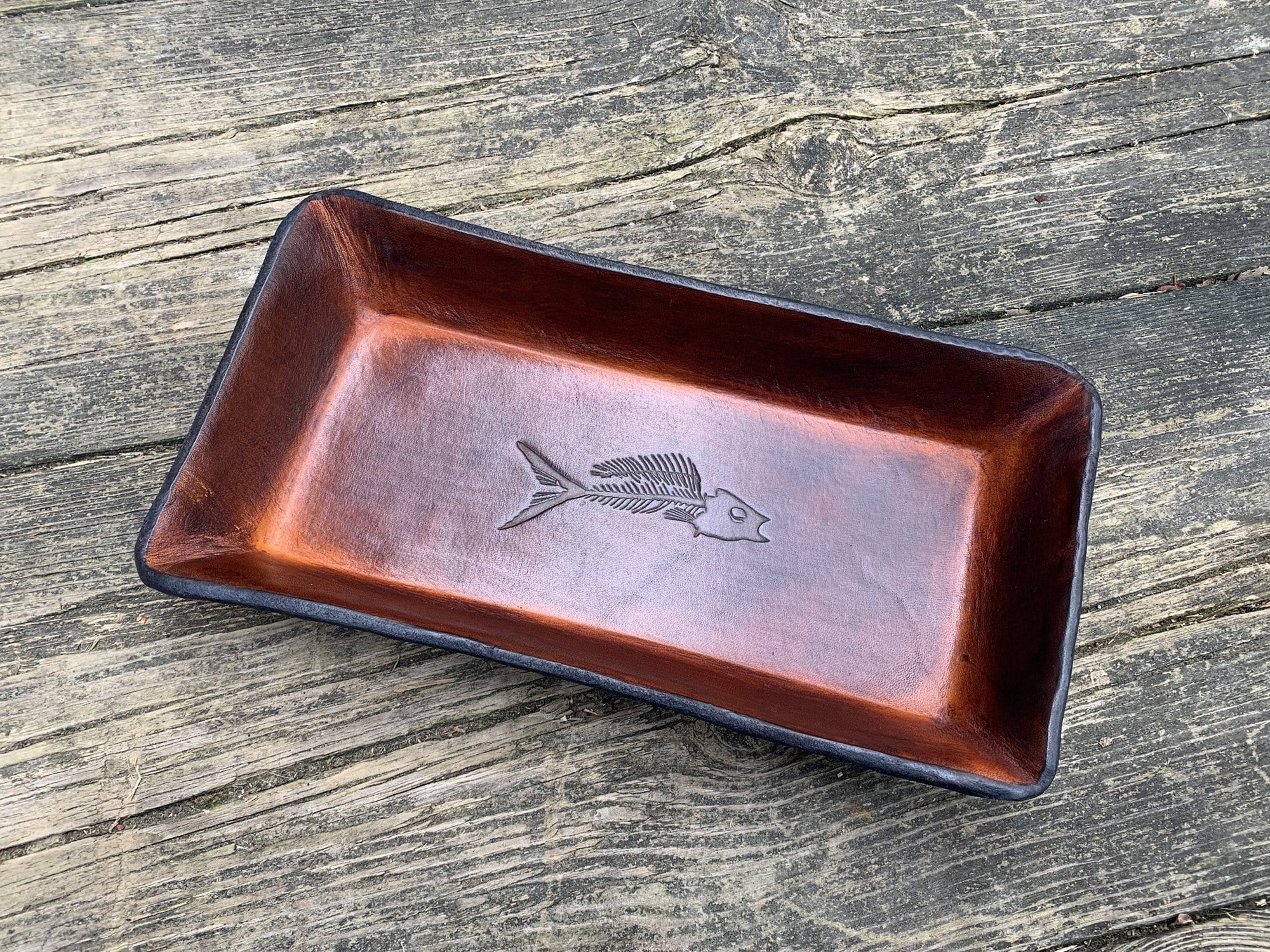 Embossed leather desk valet. fish fossil. Timber brown color.