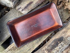 Timber brown leather tray with Four Robins logo.