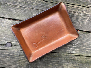 San Pedro collection tan leather tray with embossed key.