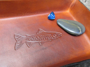 Trout image leather desk tray. Detail.