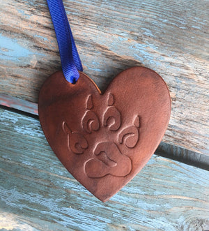 Third anniversary gift leather heart ornament. Paw print design.