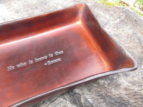 He who is brave is free by Seneca leather tray. Detail.