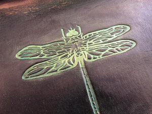 Black dragonfly leather desk tray. Closeup.