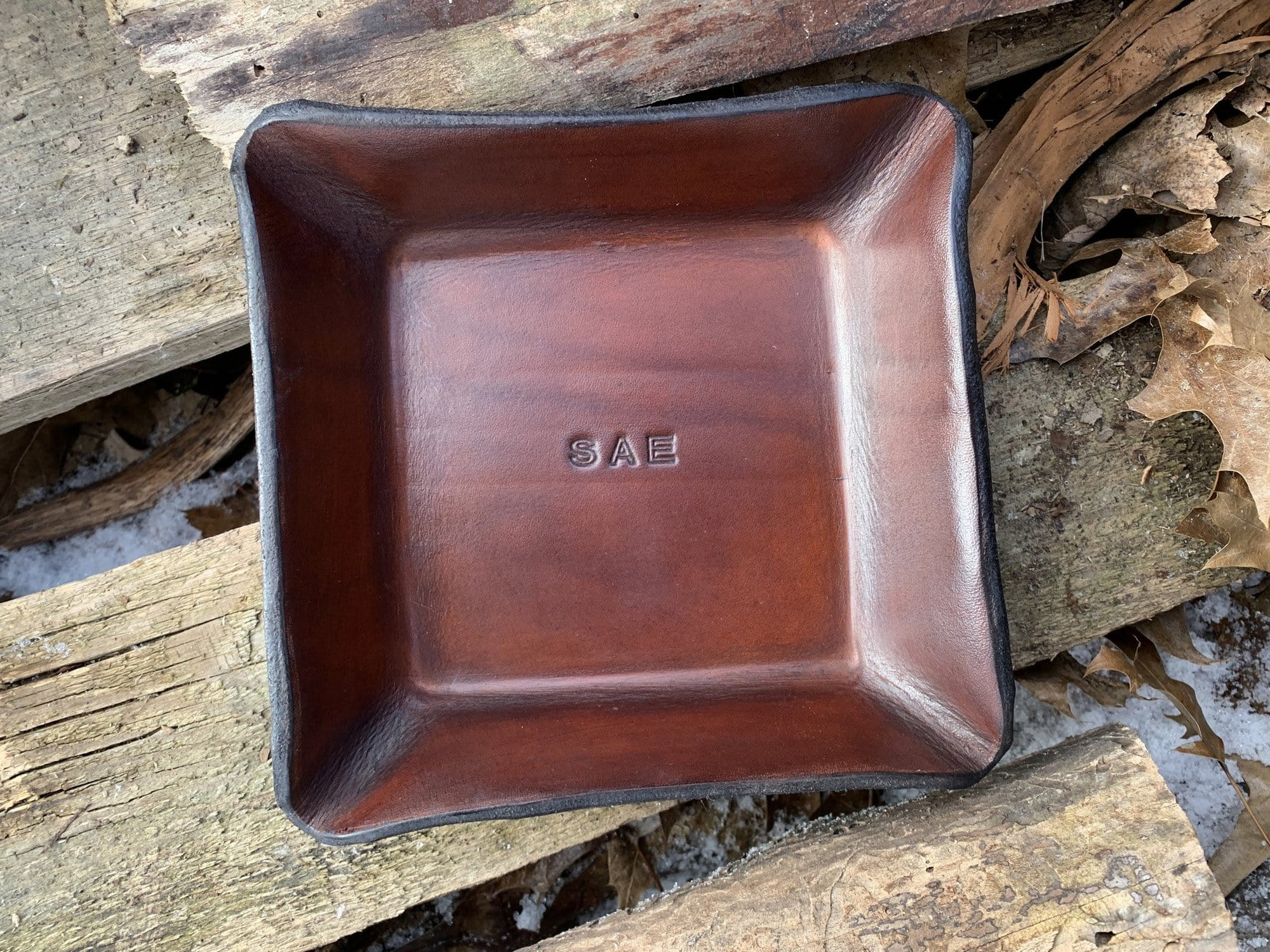 Leather valet with three letter monogram.