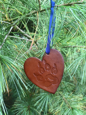 Leather Christmas ornament with embossed paw print.